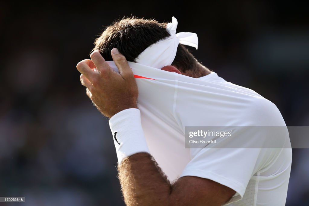 Juan Martin Del Potro of Argentina reacts during the Gentlemen's Singles fourth round match against Andreas Seppi of Italy on day seven of the Wimbledon Lawn Tennis Championships at the All England Lawn Tennis and Croquet Club on July 1, 2013 in London, England.