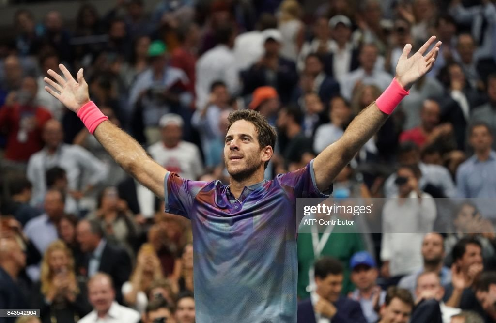 TOPSHOT - Juan Martin del Potro of Argentina reacts to his victory over Roger Federer of Switzerland during their 2017 US Open Men's Singles quarter finals match at the USTA Billie Jean King National Tennis Center in New York on September 6, 2017. /