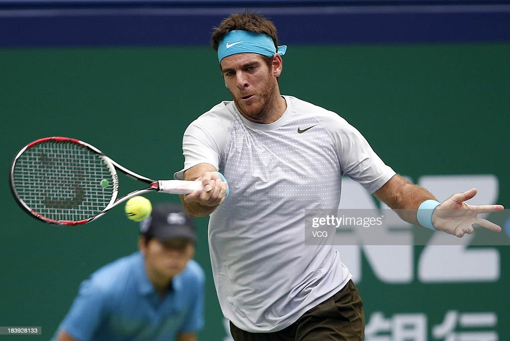 Juan Martin Del Potro of Argentina returns a ball to Philipp Kohlschreiber of Germany on day three of the Shanghai Rolex Masters at the Qi Zhong Tennis Center on October 9, 2013 in Shanghai, China.