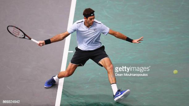 Juan Martin del Potro of Argentina returns a forehand in his match against Robin Haase of the Netherlands during Day 4 of the Rolex Paris Masters...