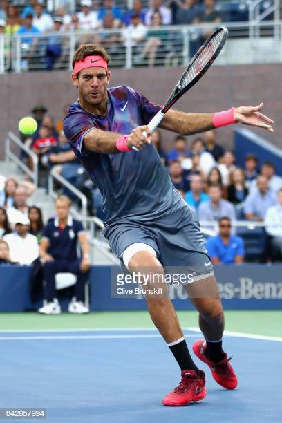 Juan Martin del Potro of Argentina returns a shot against Dominic Thiem of Austria during their fourth round Men's Singles match on Day Eight of the...