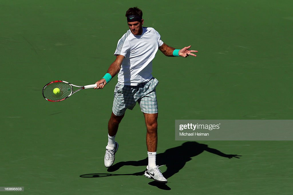 Juan Martin Del Potro of Argentina returns a shot against Rafael Nadal of Spain during their men's final match of the 2013 BNP Paribas Open at the Indian Wells Tennis Garden on March 17, 2013 in Indian Wells, California.