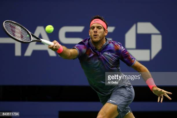 Juan Martin del Potro of Argentina returns a shot against Roger Federer of Switzerland during their Men's Singles Quarterfinal match on Day Ten of...