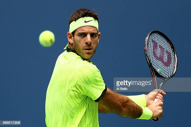 Juan Martin del Potro of Argentina returns a shot to against Dominic Thiem of Austria during his fourth round Men's Singles match on Day Eight of the...