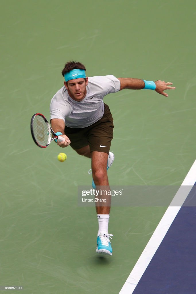 Juan Martin Del Potro of Argentina returns a shot to Philipp Kohlschreiber of Germany during day three of the Shanghai Rolex Masters at the Qi Zhong Tennis Center on October 9, 2013 in Shanghai, China.