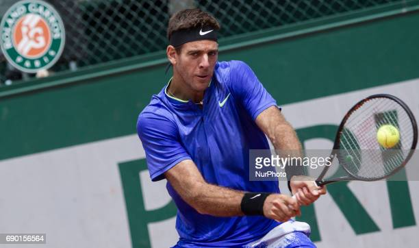 Juan Martin Del Potro of Argentina returns the ball to Guido Pella of Argentina during the first round at Roland Garros Grand Slam Tournament Day 3...