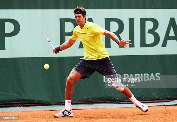 Juan Martin Del Potro of Argentina runs behind the baseline to play a forehand during his men's singles second round match against Edouard...