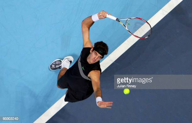 Juan Martin Del Potro of Argentina serves during the men's singles first round match against Andy Murray of Great Britain during the Barclays ATP...