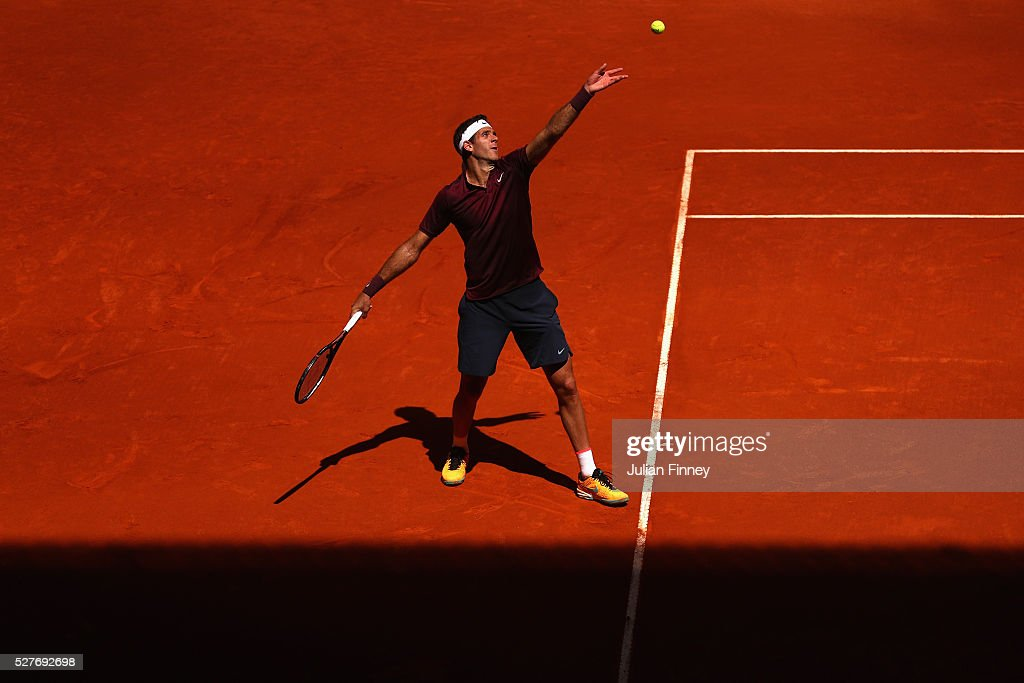 <a gi-track='captionPersonalityLinkClicked' href=/galleries/search?phrase=Juan+Martin+Del+Potro&family=editorial&specificpeople=606583 ng-click='$event.stopPropagation()'>Juan Martin Del Potro</a> of Argentina serves to Dominic Thiem of Austria during day four of the Mutua Madrid Open tennis tournament at the Caja Magica on May 03, 2016 in Madrid, Spain.