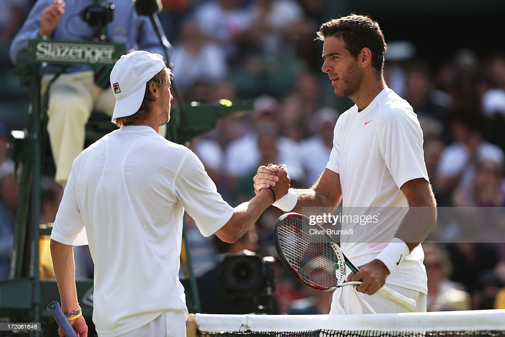 Juan Martin Del Potro of Argentina shakes hands at the net with Andreas Seppi of Italy after their Gentlemen's Singles fourth round match on day seven of the Wimbledon Lawn Tennis Championships at the All England Lawn Tennis and Croquet Club on July 1, 2013 in London, England.
