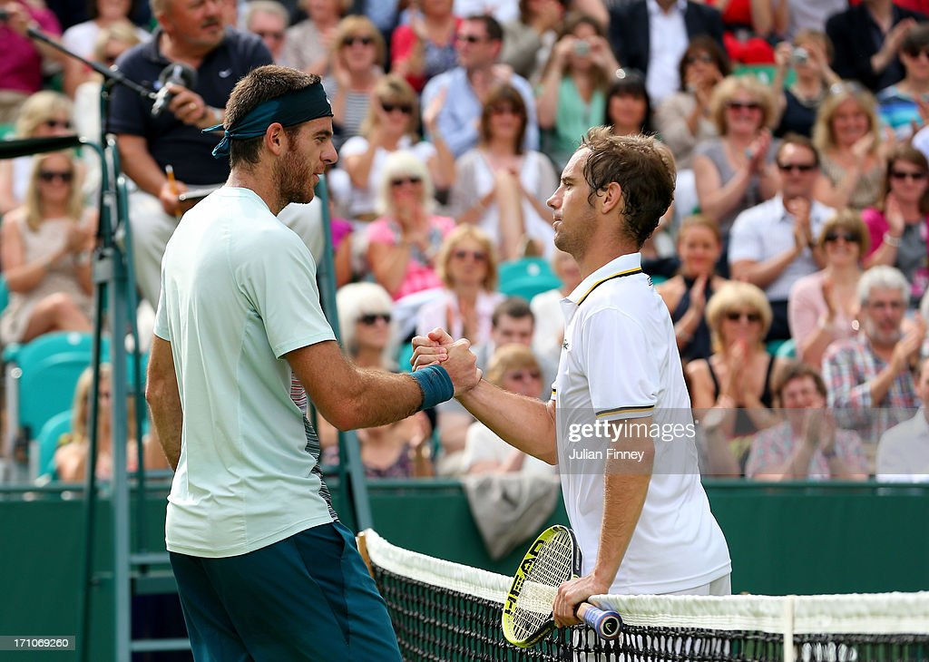Juan Martin Del Potro of Argentina shakes hands with Richard Gasquet of France during The Boodles Tennis Event at Stoke Park on June 21, 2013 in Stoke Poges, England.