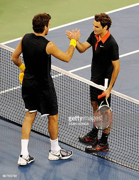 Juan Martin Del Potro of Argentina shakes hands with Roger Federer of Switzerland after del Potro won the Men's Final of the 2009 US Open at the USTA...