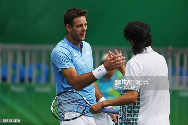 Juan Martin Del Potro of Argentina shakes hands with Taro Daniel of Japan following the men's singles third round match on Day 6 of the 2016 Rio...