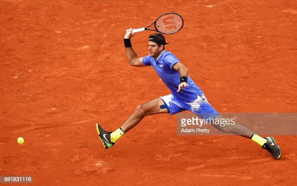 Juan Martin Del Potro of Argentina stretches for a forehand in his men's singles third round match against Andy Murray of Great Britain during day...