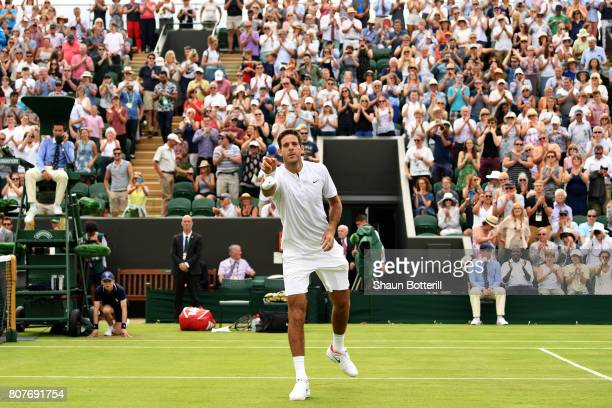 Juan Martin Del Potro of Argentina throws a wristband into the crowd after victory in the Gentlemen's Singles first round match against Thanasi...