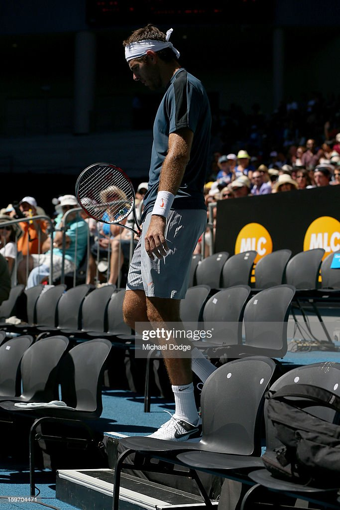 Juan Martin Del Potro of Argentina walks into the photographers area after a point in his third round match against Jeremy Chardy of France during day six of the 2013 Australian Open at Melbourne Park on January 19, 2013 in Melbourne, Australia.