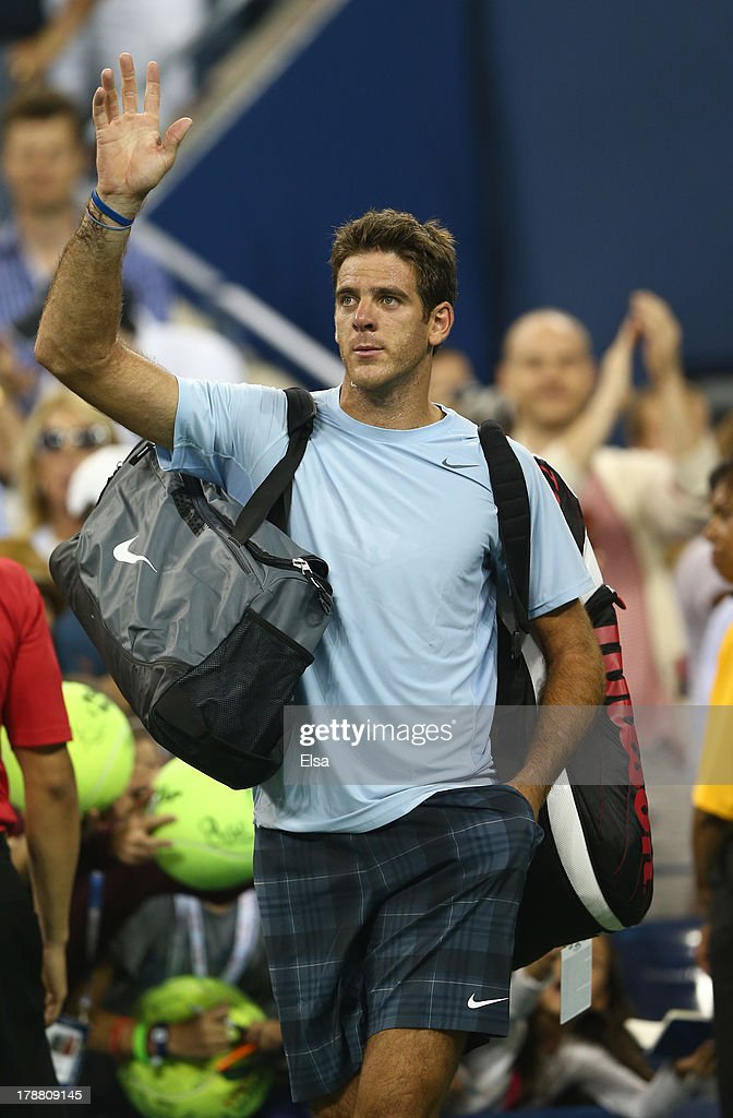 Juan Martin Del Potro of Argentina waves to the crowd after losing to Lleyton Hewitt of Australia during their match on Day Five of the 2013 US Open at USTA Billie Jean King National Tennis Center on August 30, 2013 in the Flushing neighborhood of the Queens borough of New York City.