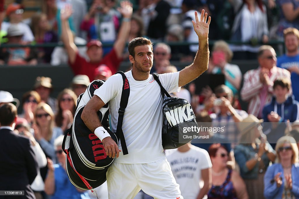Juan Martin Del Potro of Argentina waves to the crowd as he leaves the court following his victory in the Gentlemen's Singles fourth round match against Andreas Seppi of Italy on day seven of the Wimbledon Lawn Tennis Championships at the All England Lawn Tennis and Croquet Club on July 1, 2013 in London, England.