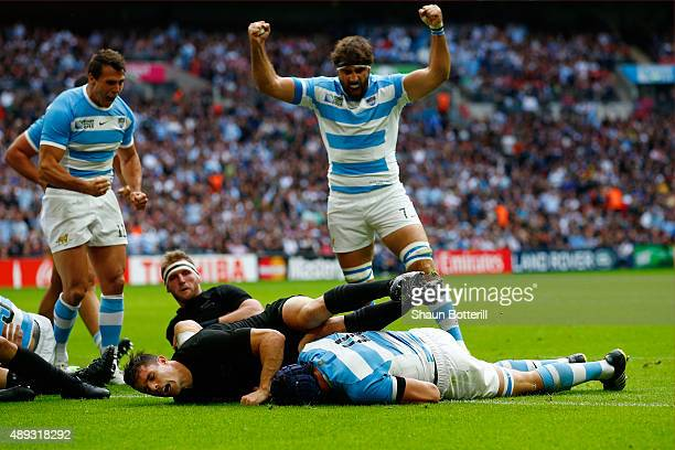 Juan Martin Fernandez Lobbe of Argentina celebrates as Guido Petti Pagadizabal of Argentina goes over to score their first try during the 2015 Rugby...