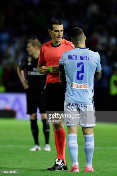 Juan Martinez Munuera talks with Hugo Mallo defender of Celta de Vigo during the La Liga Santander match between Celta de Vigo and Real Madrid at...