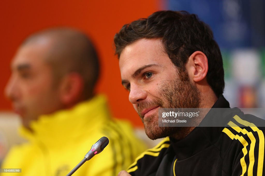 Juan Mata (R) alongside manager Roberto Di Matteo (L) during the Chelsea Training and Press Conference ahead of the UEFA Champions League Group E match between Shakhtar Donetsk and Chelsea at Donbass Arena on October 22, 2012 in Donetsk, Ukraine.