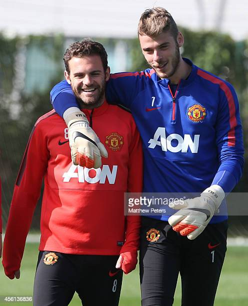 Juan Mata and David de Gea of Manchester United in action during a first team training session at Aon Training Complex on September 26 2014 in...