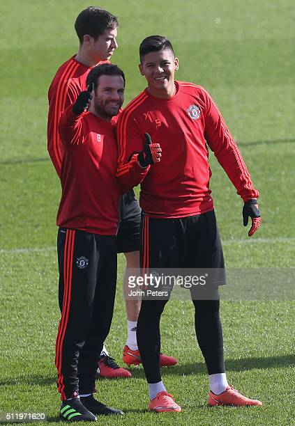 Juan Mata and Marcos Rojo of Manchester United in action during a first team training session at Aon Training Complex on February 24 2016 in...