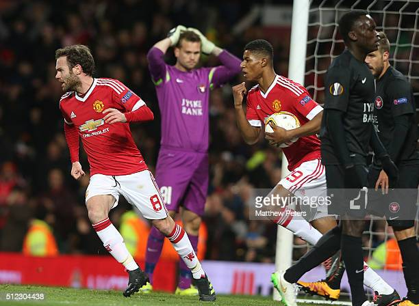 Juan Mata and Marcus Rashford of Manchester United celebrate Nikolay Bodurov of FC Midtjylland scoring an owngoal during the UEFA Europa League match...
