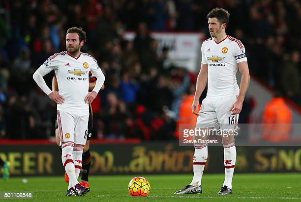 Juan Mata and Michael Carrick of Manchester United show their dejection after conceding second goal to Bournemouth during the Barclays Premier League...