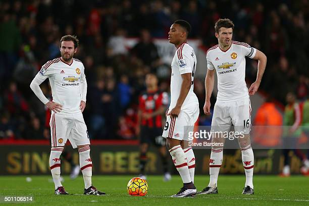 Juan Mata Anthony Martial and Michael Carrick of Manchester United show their dejection after conceding second goal to Bournemouth during the...