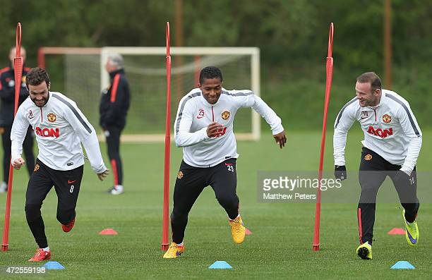 Juan Mata Antonio Valencia and Wayne Rooney of Manchester United in action during a first team training session at Aon Training Complex on May 8 2015...