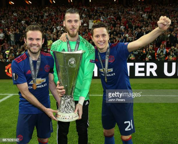 Juan Mata David de Gea and Ander Herrera of Manchester United celebrate with the Europa League trophy after the UEFA Europa League Final match...