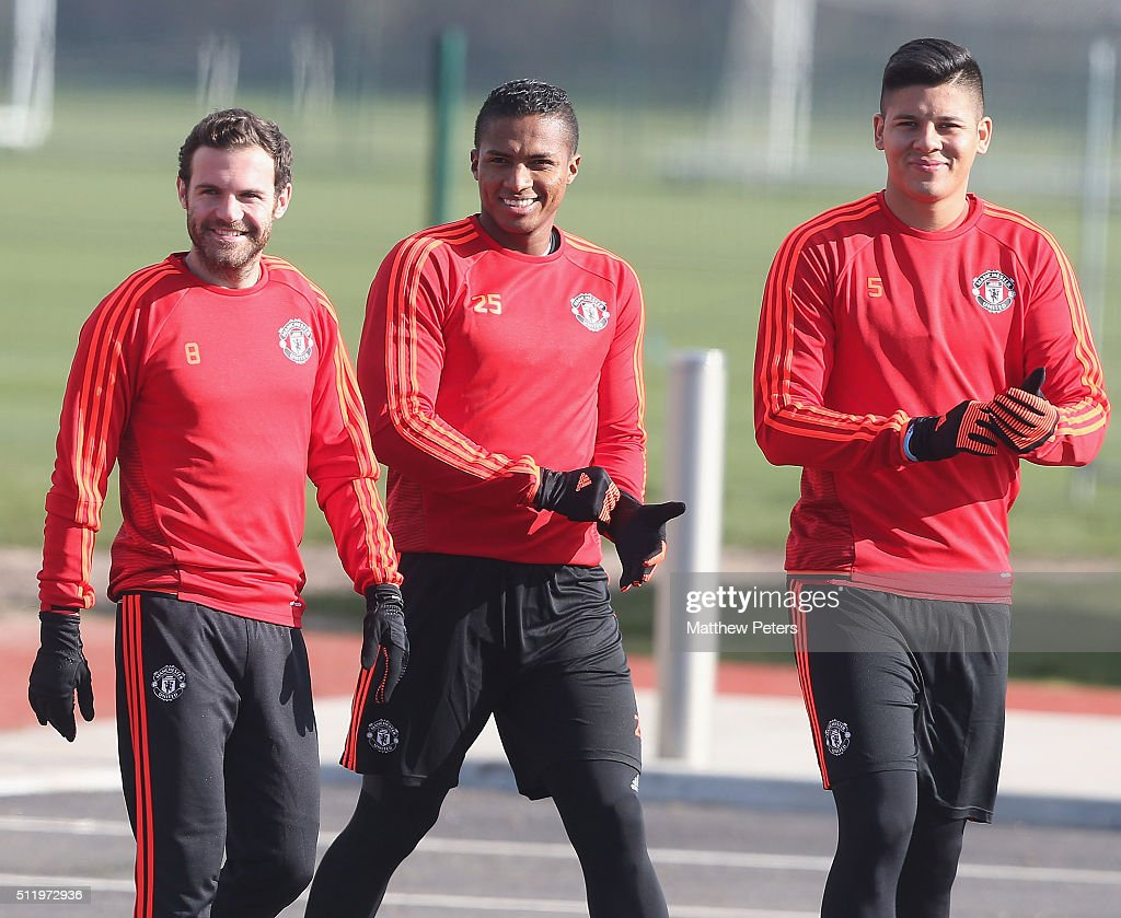Juan Mata, Marcos Rojo and Antonio Valencia of Manchester United in action during a first team training session at Aon Training Complex on February 24, 2016 in Manchester, United Kingdom.