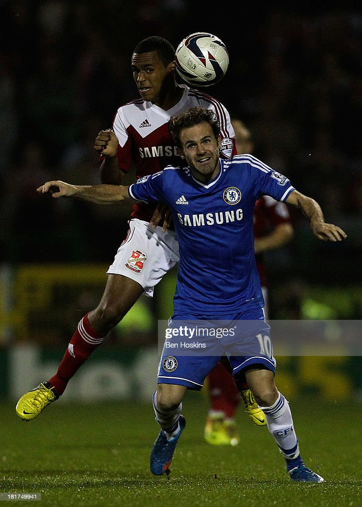 <a gi-track='captionPersonalityLinkClicked' href=/galleries/search?phrase=Juan+Mata&family=editorial&specificpeople=4784696 ng-click='$event.stopPropagation()'>Juan Mata</a> of Chelsea battles with Nathan Thompson of Swindon during the Capital One Cup third round match between Swindon Town and Chelsea at County Ground on September 24, 2013 in Swindon, England.