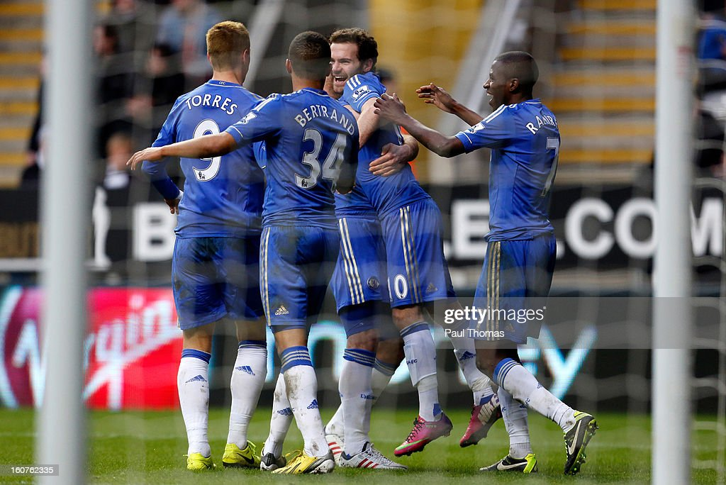<a gi-track='captionPersonalityLinkClicked' href=/galleries/search?phrase=Juan+Mata&family=editorial&specificpeople=4784696 ng-click='$event.stopPropagation()'>Juan Mata</a> (C) of Chelsea celebrates his goal with team mates during the Premier League match between Newcastle United and Chelsea at St James Park on February 2, 2013 in Newcastle, England.