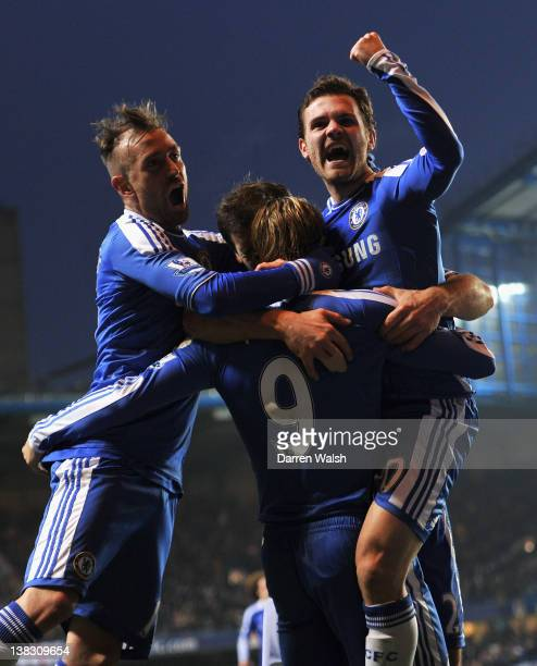 Juan Mata of Chelsea celebrates scoring his side's second goal with team mates Raul Meireles and Fernando Torres during the Barclays Premier League...