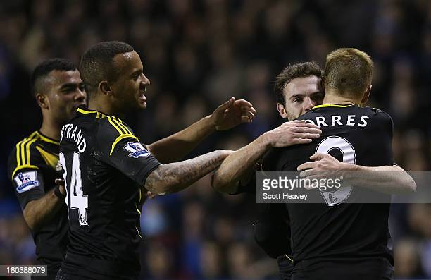 Juan Mata of Chelsea celebrates scoring the opening goal with Fernando Torres Ryan Bertrand and Ashley Cole during the Barclays Premier League match...