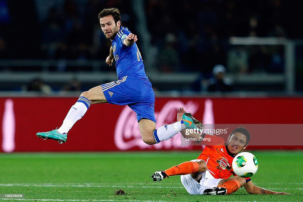 Juan Mata (L) of Chelsea challenges Neri Cardozo of Monterrey during the FIFA Club World Cup Semi Final match between CF Monterrey and Chelsea at International Stadium Yokohama on December 13, 2012 in Yokohama, Japan.