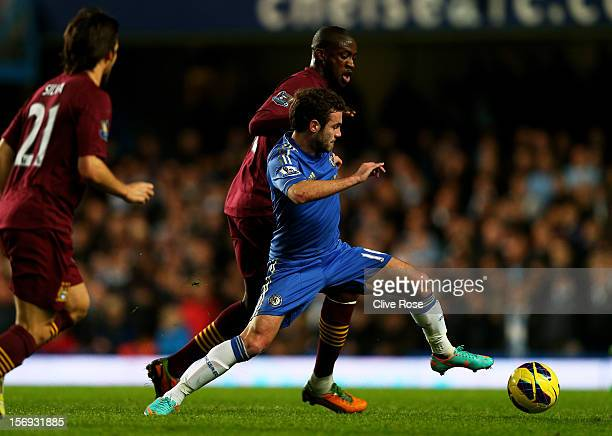 Juan Mata of Chelsea holds off the challenge from Yaya Toure of Manchester City during the Barclays Premier League match between Chelsea and...