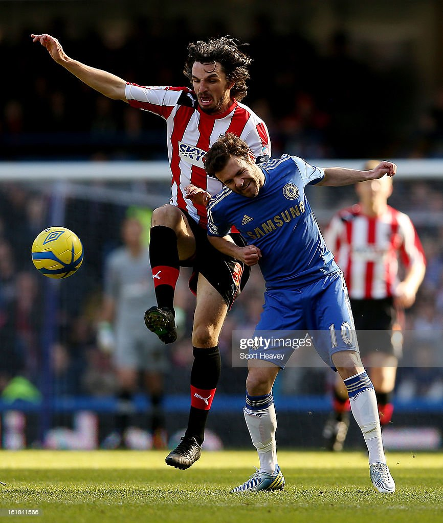 Juan Mata of Chelsea (R) in action with Jonathan Douglas of Brentford during the FA Cup Fourth Round Replay between Chelsea and Brentford at Stamford Bridge on February 17, 2013 in London, England.