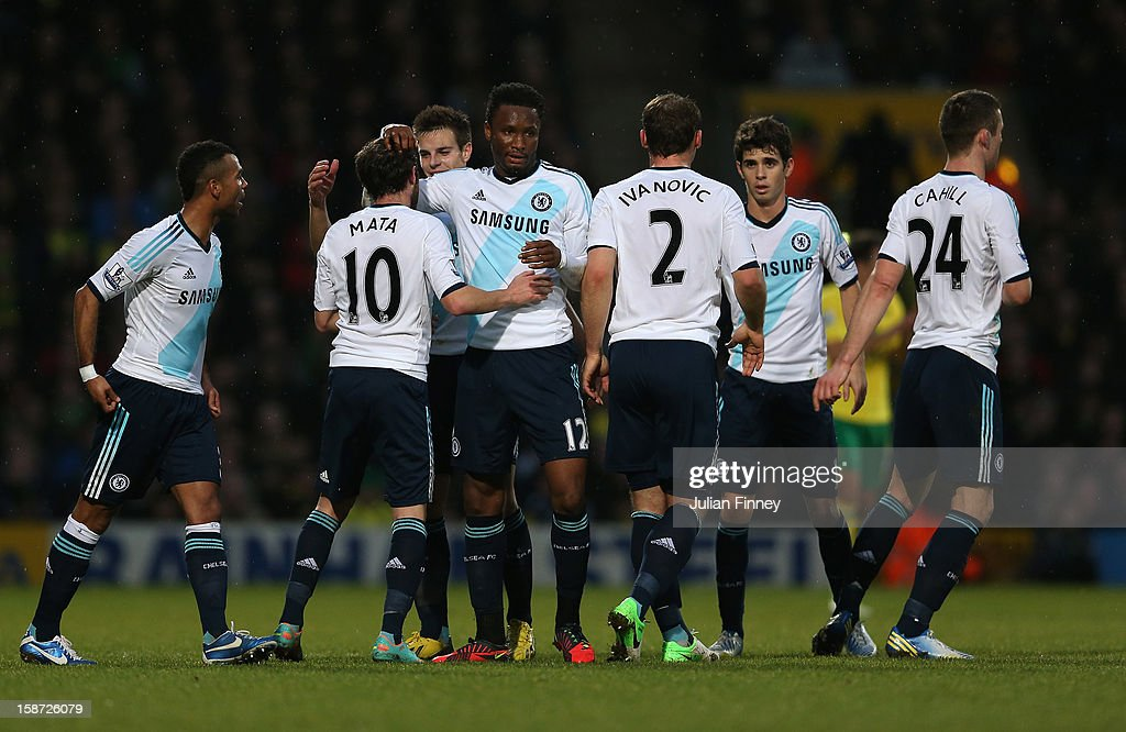 Juan Mata of Chelsea is congratulated by team mates after scoring the first goal during the Barclays Premier League match between Norwich City and Chelsea at Carrow Road on December 26, 2012 in Norwich, England.