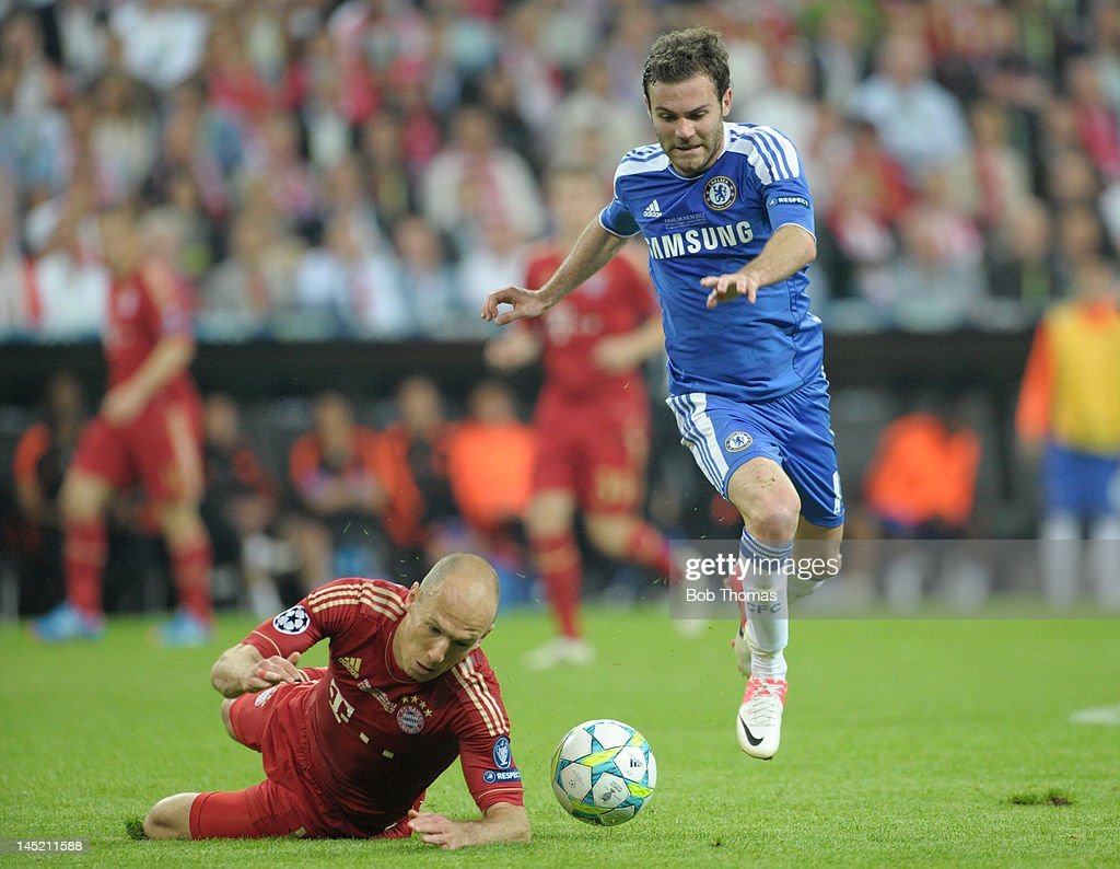 Juan Mata of Chelsea jumps clear of a challenge from Arjen Robben of Bayern Munich during the UEFA Champions League Final between FC Bayern Munich and Chelsea at the Fussball Arena Munich on May 19, 2012 in Munich, Germany. The match ended 1-1 after extra time, Chelsea won 4-3 on penalties.
