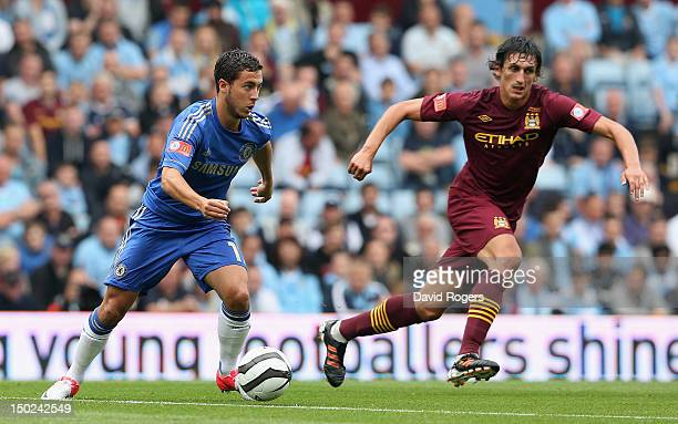 Juan Mata of Chelsea moves away from Stefan Savic during the FA Community Shield match between Manchester City and Chelsea at Villa Park on August 12...