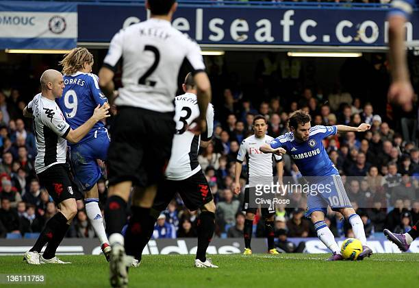 Juan Mata of Chelsea scores the opening goal during the Barclays Premier League match between Chelsea and Fulham at Stamford Bridge on December 26...