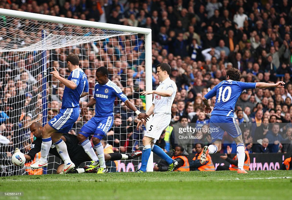 <a gi-track='captionPersonalityLinkClicked' href=/galleries/search?phrase=Juan+Mata&family=editorial&specificpeople=4784696 ng-click='$event.stopPropagation()'>Juan Mata</a> of Chelsea scores the winning goal during the Barclays Premier League match between Chelsea and Wigan Athletic at Stamford Bridge on April 7, 2012 in London, England.