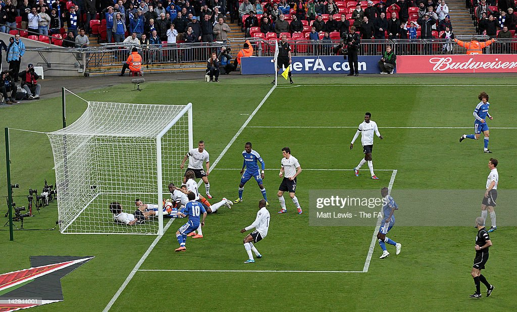 <a gi-track='captionPersonalityLinkClicked' href=/galleries/search?phrase=Juan+Mata&family=editorial&specificpeople=4784696 ng-click='$event.stopPropagation()'>Juan Mata</a> of Chelsea scores their second goal during the FA Cup with Budweiser Semi Final match between Tottenham Hotspur and Chelsea at Wembley Stadium on April 15, 2012 in London, England.
