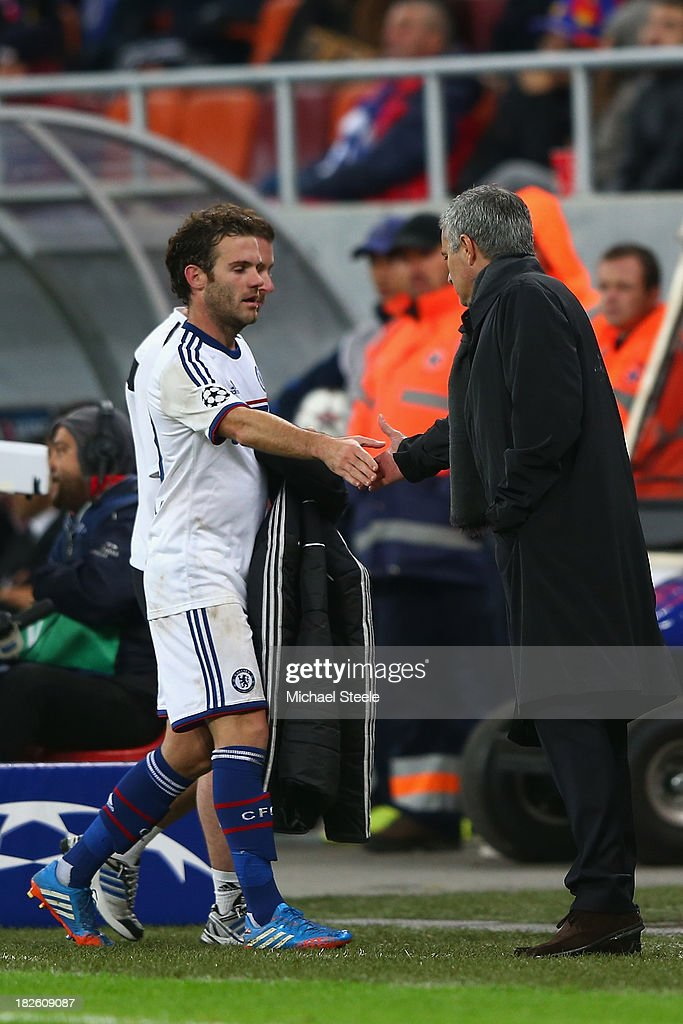 <a gi-track='captionPersonalityLinkClicked' href=/galleries/search?phrase=Juan+Mata&family=editorial&specificpeople=4784696 ng-click='$event.stopPropagation()'>Juan Mata</a> (L) of Chelsea shakes hands with manager Jose Mourinho (R) after being substituted during the UEFA Champions League Group E Match between FC Steaua Bucuresti and Chelsea at the National Arena Stadium on October 1, 2013 in Bucharest, Romania.