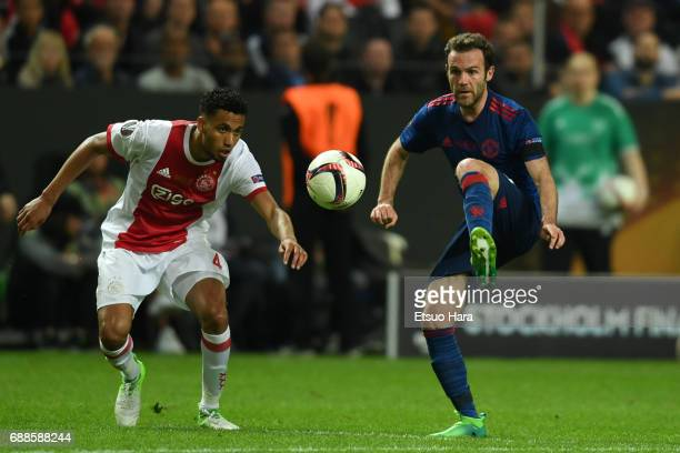 Juan Mata of Manchester United and Jairo Riedewald of Ajax compete for the ball during the UEFA Europa League final match between Ajax and Manchester...