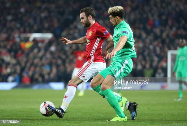 Juan Mata of Manchester United and Kevin Malcuit of SaintEtienne in action during the UEFA Europa League Round of 32 first leg match between...