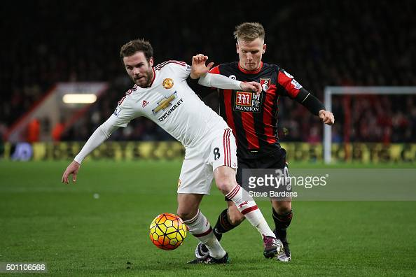 Juan Mata of Manchester United and Matt Ritchie of Bournemouth compete for the ball during the Barclays Premier League match between AFC Bournemouth...